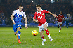 Joe Bryan of Bristol City is challenged by Marcus Maddison of Peterborough United - Photo mandatory by-line: Rogan Thomson/JMP - 07966 386802 - 28/11/2014 - SPORT - FOOTBALL - Peterborough, England - ABAX Stadium - Peterborough United v Bristol City - Sky Bet League 1.