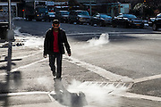 A man crosses a road passing steam coming out of the  air vents coming out of the road in Manhattan, New York City, New York, United States of America.  (photo by Andrew Aitchison / In pictures via Getty Images)