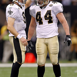 September 9, 2010; New Orleans, LA, USA;  New Orleans Saints quarterback Drew Brees (9) and running back Heath Evans (44) celebrates in the final seconds of a 14-9 win over the Minnesota Vikings in the NFL Kickoff season opener at the Louisiana Superdome.  Mandatory Credit: Derick E. Hingle