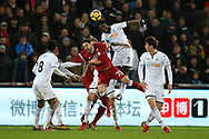 Danny Ings of Liverpool appeals as he appears to be held back by Swansea city's Mike van der Hoorn as Swansea city's Wilfried Bony (2) heads. Premier league match, Swansea city v Liverpool at the Liberty Stadium in Swansea, South Wales on Monday 22nd January 2018. <br /> pic by  Andrew Orchard, Andrew Orchard sports photography.