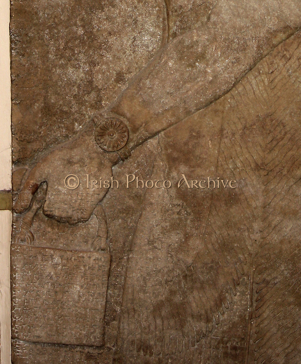 Detail from wall carving of Eagle-headed protective spirit. Assyrian, (approx. 865-860 BC). From the North-West Palace in Nimrud.