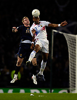 Photo: Jed Wee.<br />Scotland v France. UEFA European Championships 2008 Qualifying. 07/10/2006.<br /><br />France's Jean Alain Boumsong (R) jumps with Scotland's Garry O'Connor.