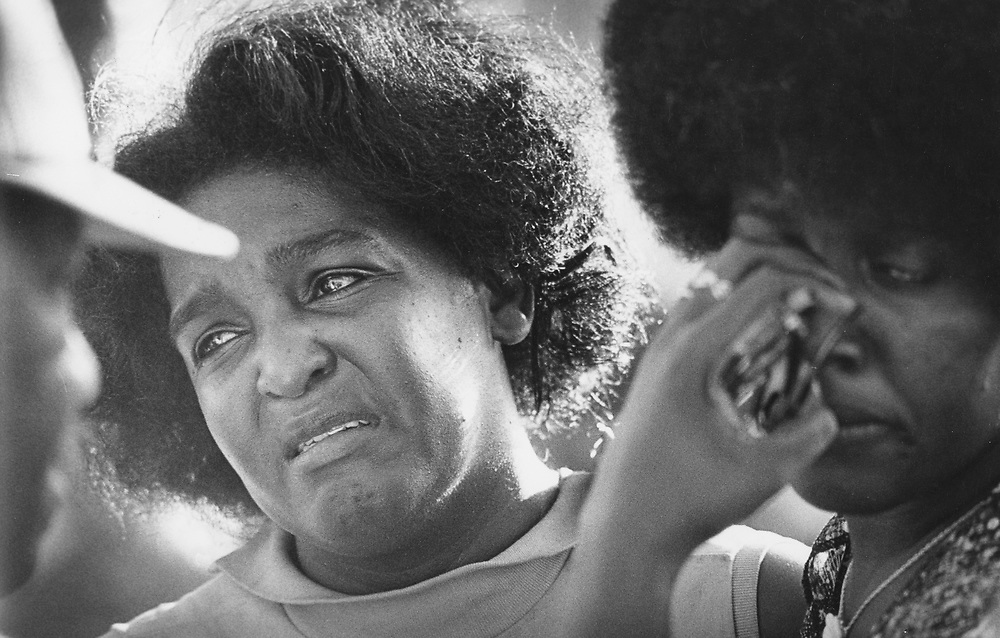 ©1978 Woman grieves at shooting scene that killed her brother, College Station, Texas