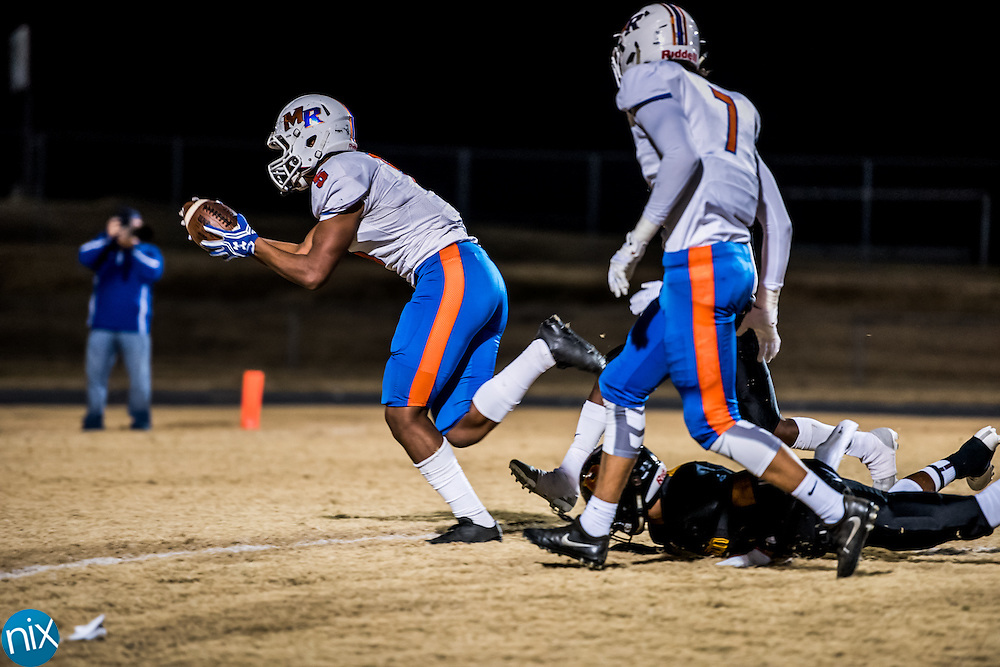 Marvin Ridge's Devin Powell (5) scores against Jay M. Robinson Friday night during the second round of the NCHSAA 3AA playoffs. Marvin Ridge won the game 48-28 and will play Hickory Ridge next week.