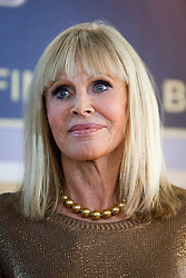 © Licensed to London News Pictures. 24/09/2012. LONDON, UK. Bond girl Britt Ekland, who played Bond Girl 'Goodnight' in 'The Man with the Golden Gun' is seen inside HMV's Oxford Street store in London, today (24/09/12) during a photocall. The stars were in London during the final leg of a UK tour to promote the Bond 50 Blu-Ray collection.  Photo credit: Matt Cetti-Roberts/LNP