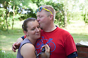Loving man embracing and kissing his happy wife. Zawady Central Poland