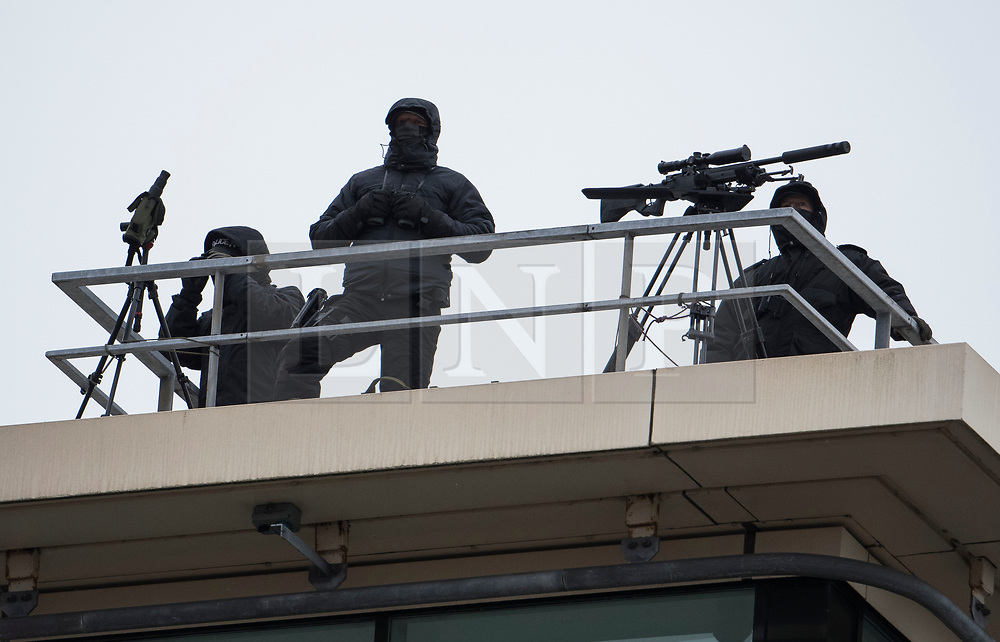 © Licensed to London News Pictures. 04/10/2017. Manchester, UK. Armed police with sniper rifles seen on the final day of the Conservative Party Conference. The four day event is expected to focus heavily on Brexit, with the British prime minister hoping to dampen rumours of a leadership challenge. Photo credit: Ben Cawthra/LNP