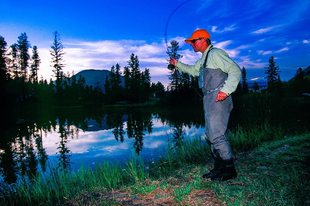 Flyfishing in a pond in West Glacier, Glacier National Park, Montana USA