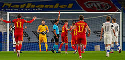 CARDIFF, WALES - Wednesday, November 18, 2020: Referee Jesús Gil Manzano shows a red card to Finland's Jere Uronen (hidden R) during the UEFA Nations League Group Stage League B Group 4 match between Wales and Finland at the Cardiff City Stadium. Wales won 3-1 and finished top of Group 4, winning promotion to League A. (Pic by David Rawcliffe/Propaganda)