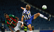 Pepe of Porto(R) jumps for the ball with Kibe of Maritimo during the Portuguese League (Liga NOS) match between FC Porto and Maritimo at Estadio do Dragao, Porto, Portugal on 3 October 2020.