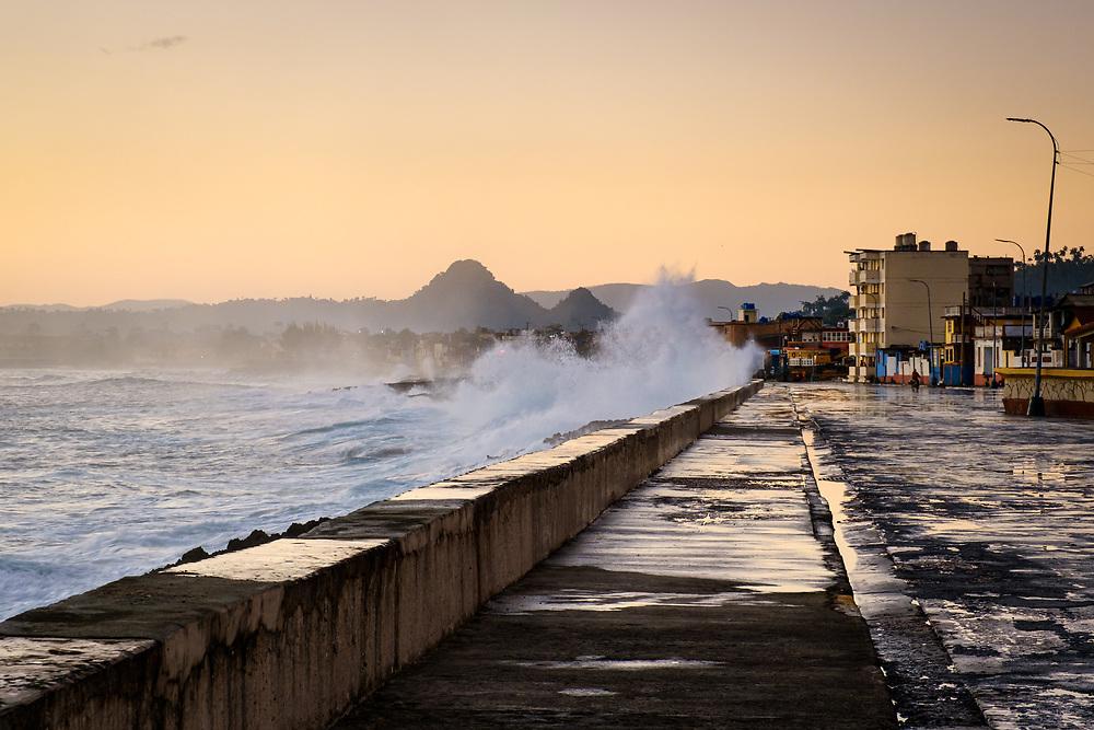 BARACOA, CUBA - CIRCA JANUARY 2020: View of the Malecon in Baracoa during sunrise.