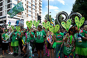 Notting Hill Carnival August 27th 2017 in London, United Kingdom. At 3pm there was a minute's silence in honour of the vicctims of the Grenfell Tower Fire. Many people, including survivors, wore green as tribute.
