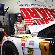 Racecar driver Dale Earnhardt Jr. is seen in his garage area during the  56th Annual NASCAR Daytona 500 practice session at Daytona International Speedway on Wednesday, February 19, 2014 in Daytona Beach, Florida.  (AP Photo/Alex Menendez)