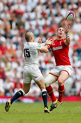 George North of Wales is challenged by Mike Brown of England - Mandatory byline: Rogan Thomson/JMP - 29/05/2016 - RUGBY UNION - Twickenham Stadium - London, England - England Rugby v Wales - Old Mutual Wealth Cup.