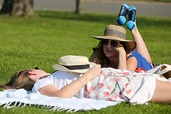 © Licensed to London News Pictures. 13/09/2020. London, UK. Women enjoy warm and sunny weather in Finsbury Park, north London as mini heatwave hits London.<br /> <br /> ***Permission Granted***<br /> <br /> Photo credit: Dinendra Haria/LNP