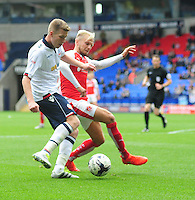 Bolton Wanderers's Josh Vela is tackled by Fleetwood Town's David Ball<br /> <br /> Photographer Chris Vaughan/CameraSport<br /> <br /> Football - The EFL Sky Bet League One - Bolton Wanderers v Fleetwood Town - Saturday 20 August 2016 - Macron Stadium - Bolton<br /> <br /> World Copyright © 2016 CameraSport. All rights reserved. 43 Linden Ave. Countesthorpe. Leicester. England. LE8 5PG - Tel: +44 (0) 116 277 4147 - admin@camerasport.com - www.camerasport.com