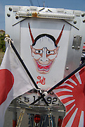 Japanese flags and devil illustration on the back of a decochari customized bicycle.