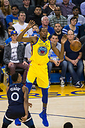 Minnesota Timberwolves guard Jeff Teague (0) strips the ball from Golden State Warriors forward Kevin Durant (35) during a shot attempt at Oracle Arena in Oakland, Calif., on January 25, 2018. (Stan Olszewski/Special to S.F. Examiner)