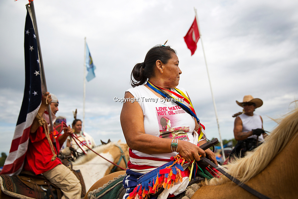 Tania Aubid (center) rides through the resistance camp against the Dakota Access oil pipeline on September 9, 2016. Cannon Ball, North Dakota, United States.