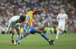 August 27, 2017 - Madrid, Spain - Kongdobia takes the ball away from Isco. LaLiga Santander matchday 2 between Real Madrid and Valencia. The final score was 2-2, Marco Asensio scored twice for Real Madrid. Carlos Soler and Kondogbia did it for Valencia. Santiago Bernabeu Stadium, august 27, 2017. Photo by  (Credit Image: © |Antonio Pozo |  Media Expre/VW Pics via ZUMA Wire)
