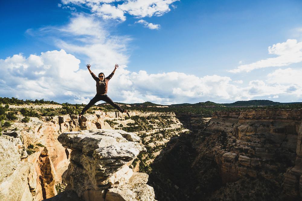 Shiho Kobayashi jumps for joy at Cold Shivers lookout, Colorado National Monument.