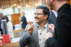 """18 September 2017, Geneva, Switzerland: A """"marketplace"""" at the Ecumenical Centre in Geneva presents resources and activities of the World Council of Churches, at it hosts a meeting of member churches' Ecumenical Officers. Here, Dinesh Suna."""