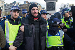 """London, April 16th 2016. A man from a group of protesters dancing in Trafalgar Square is arrested on allegations of being in possession of cannabis after thousands of people supported by trade unions and other rights organisations demonstrated against the policies of the Tory government, including austerity and perceived favouring of """"the rich"""" over """"the poor""""."""