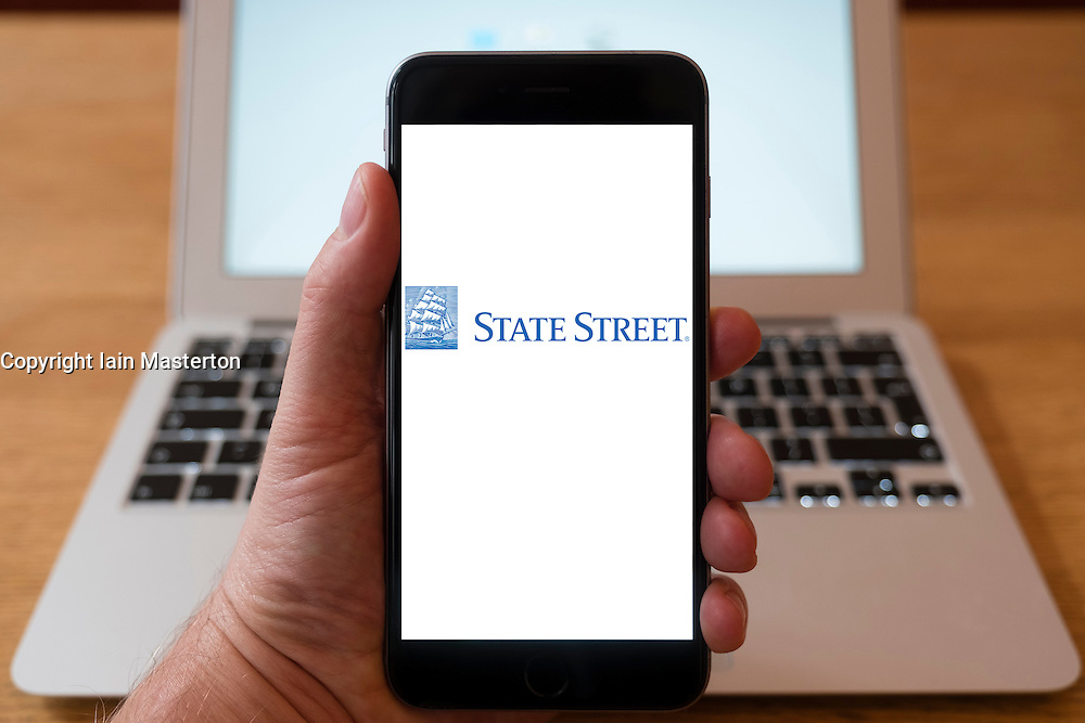 Using iPhone smartphone to display logo of State Street an American worldwide financial services holding company