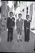 three boys posing in their sunday best clothing on their holy communion day 1950s