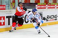 04.April 2012; Rapperswil-Jona; Eishockey - Schweiz - Finnland;<br />  Damien Brunner (SUI) gegen Aleksi Laakso (FIN) (Thomas Oswald)