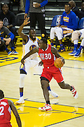 Golden State Warriors forward Draymond Green (23) defends Los Angeles Clippers forward Brandon Bass (30) during a NBA preseason game at Oracle Arena in Oakland, Calif., on October 4, 2016. (Stan Olszewski/Special to S.F. Examiner)