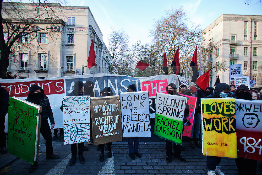 © Licensed to London News Pictures. 11/12/2013. London, United Kingdom. The National Campaign Against Fees and Cuts protests outside the University of London Union, claiming that police 'have violently evicted, beaten, and arrested students from peaceful occupations in London and sent undercover police officers to spy on students'.  Photo credit : Andrea Baldo/LNP