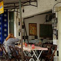 South America, Brazil, Rio de Janeiro. Sidewalk Restaurant at Favela of Vila Canoas.