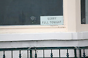 Guest House bed and breakfast sign 'sorry full tonight', Lowestoft, Suffolk, England