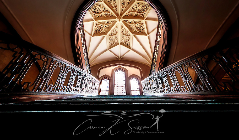 A staircase leads to the upper floor of Callanwolde Fine Arts Center and offers visitors a glimpse of the intricately-crafted Aerolian organ rib vault on the ceiling. Callanwolde is housed within a 27,000 square foot Gothic-Tudor Revival mansion and nestled on 12 acres in Atlanta, Georgia. The house, built in 1920, was the home of Charles Howard Candler, son of the founder of the Coca-Cola Company. The house was designed by architect Henry Hornbostel. Today, Callanwolde operates as a non-profit organization devoted to teaching and promoting the visual, literary and performing arts. (Photo by Carmen K. Sisson/Cloudybright)