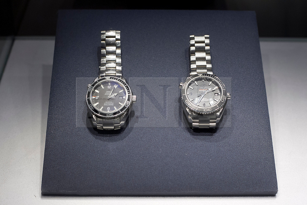 """© Licensed to London News Pictures. 28/09/2012. LONDON, UK. A pair of Automatic Seamaster Professional """"Planet Ocean"""" wrist watches worn by Daniel Craig on Bond films 'Quantum of Solace' (2008) and 'Skyfall' (2012) (each est. £6,000-8,000) are seen at the press view for the 50 Years of James Bond Auction in London today (28/09/12).  The auction, taking place on in two parts, an online sale on the 28th of September and an evening event on the 5th of October - Global James Bond Day -  is being held in aid of various charities and features props and costumes from 50 years of James Bond movies. Photo credit: Matt Cetti-Roberts/LNP"""
