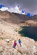 Kids (ages 5 & 9) playing on boulders above Cottonwood Lake #6, John Muir Wilderness, Sierra Nevada Mountains, California