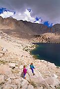 Kids (ages 5 & 9) playing on boulders above Cottonwood Lake #6, John Muir Wilderness, Sierra Nevada Mountains, California