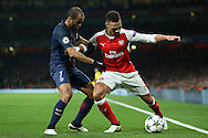 Kieran Gibbs of Arsenal holds off Lucas of Paris Saint-Germain. UEFA Champions league group A match, Arsenal v Paris Saint Germain at the Emirates Stadium in London on Wednesday 23rd November 2016.<br /> pic by John Patrick Fletcher, Andrew Orchard sports photography.