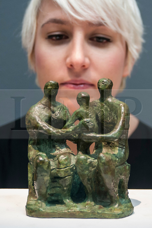 """© Licensed to London News Pictures. 28/01/2016. London, UK.   """"Family Group"""" by Henry Moore (est. £0.25-0.35m), on display at Sotheby's preview of its upcoming Impressionist, Modern & Surrealist art sale on 3 February featuring works by some of the most important artists of the 20th century.  The combined total of the evening sale is expected to exceed £100m. Photo credit : Stephen Chung/LNP"""
