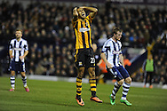Hull city's Ahmed Elmohamady reacts after he sees his shot saved at point blank range by WBA keeper Ben Foster (out of pic). Barclays Premier league, West Bromwich Albion v Hull city at the Hawthorns in West Bromwich, England on Saturday 21st Dec 2013. pic by Andrew Orchard, Andrew Orchard sports photography.