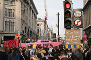 April, 18th, 2019 - London, Greater London, United Kingdom: Demonstration against Climate Crisis. Extinction Rebellion is demanding the UK government takes urgent action on climate change and wildlife declines. Extinction Rebellion activists disrupt traffic around famous London Landmarks. Thousands of protesters  converging on central hubs including Oxford Circus and Parliament Square. Nigel Dickinson/Polaris