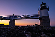 Dawn breaks over the Marshall Point Lighthouse along the rocky coast near Port Clyde, Maine. The current lighthouse was built in 1832 on a rocky point of land near the mouth of Port Clyde Harbor and was featured in the major motion picture Forrest Gump.