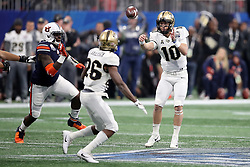 UCF Knights quarterback McKenzie Milton (10) throws a pass during the 2018 Chick-fil-A Peach Bowl NCAA football game against the Auburn Tigers on Monday, January 1, 2018 in Atlanta. (Jason Parkhurst / Abell Images for the Chick-fil-A Peach Bowl)