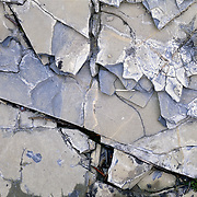 The fractured slate along the banks of a river near Logan Pass in Glacier National Park, Montana.