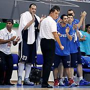Anadolu Efes's coach Ufuk SARICA (F) during their Turkey Cup Qualifying basketball first match Anadolu Efes between Turk Telekom at Aliaga Arena in Izmir, Turkey, Sunday, October 9, 2011. Photo by TURKPIX