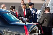 17 FEBRUARY 2009 -- President Barack Obama holds up the Shaq shoe given to him by Mayor Phil Gordon  during the arrival of President Barack Obama at Sky Harbor Airport Tuesday.      PHOTO BY JACK KURTZ