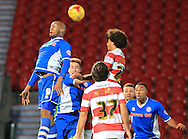 Calvin Andrew, Keshi Anderson during the Sky Bet League 1 match between Doncaster Rovers and Rochdale at the Keepmoat Stadium, Doncaster, England on 21 November 2015. Photo by Daniel Youngs.