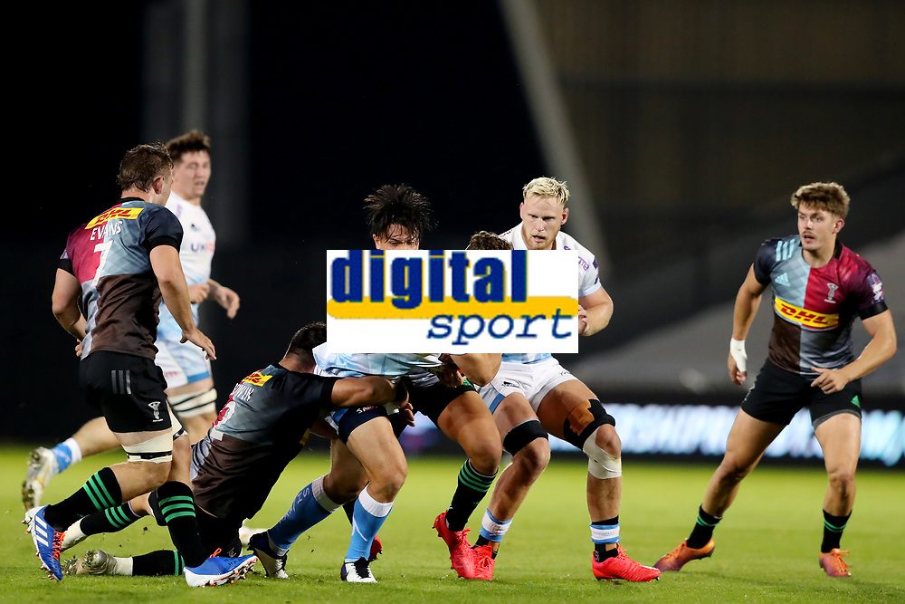 Rugby Union - 2019 / 2020 Premiership Rugby Cup - Final - Sale Sharks vs Harlequins<br /> <br /> Rohan Janse van Rensburg of Sale Sharks is tackled by Scott Baldwin, Will Evans and Marcus Smith of Harlequins, at the A J Bell Stadium.<br /> <br /> COLORSPORT/PAUL GREENWOOD