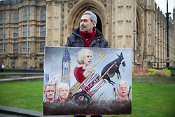 © Licensed to London News Pictures. 01/02/2017. London, UK. Artist Kaya Mar stands with his Brexit-themed artwork outside the Houses of Parliament. Today, MPs go into the second day of debating the Article 50 Bill. Photo credit : Tom Nicholson/LNP
